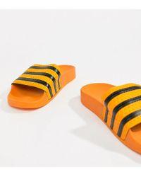 6b7b33187160 adidas Originals - Adilette Slider Sandals In Orange - Lyst