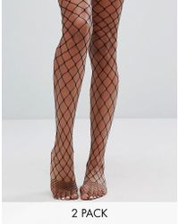 ASOS - 2 Pack Oversized Fishnet Tights In Black And Orange - Lyst