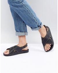 Office - Supernova Black Studded Cross Front Sandals - Lyst