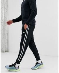 Nike - Joggers negros Tribute - Lyst