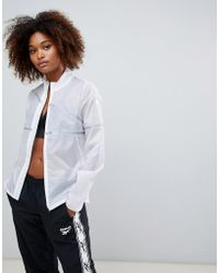 Reebok - Training Hero Reflective Jacket - Lyst