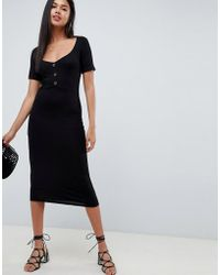 ee4c08a7a4d6 ASOS Cross Front Halter Neck Midi Dress in Black - Lyst