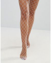 176dee28a ASOS - Asos Oversized Fishnet Tights In Light Blue - Lyst
