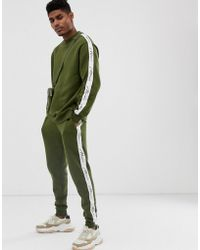 bf18ba3a9eca BoohooMAN - Tracksuit With Man Taping In Khaki - Lyst