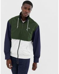 Lacoste - Giacca colour block blu navy con zip - Lyst