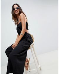5eef869044 ASOS - Bandeau Jumpsuit With Cut Out And Drape Detail - Lyst