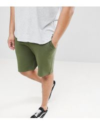 ASOS - Plus Jersey Skinny Shorts In Khaki With Black Contrast Trims - Lyst