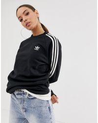 50e264186cce adidas Originals - Adicolor Three Stripe Crew Neck Sweat In Black - Lyst