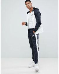 Nike - Tuta nera a blocchi di colore 928119-011 - Lyst