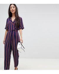 ASOS - Asos Design Petite Wrap Jumpsuit With Self Buckle In Stripe - Lyst