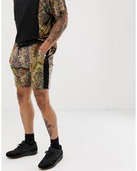 ASOS - Pantalones cortos ajustados de velour de conjunto con estampado floral de - Lyst