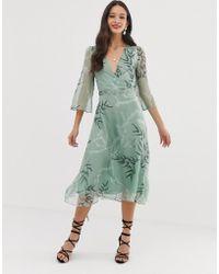 Liquorish - Midi-jurk Met Bladerprint - Lyst
