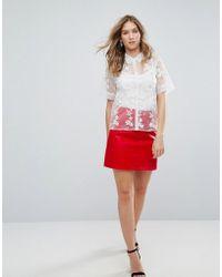 570e05a4d8b2 Ganni Leopard Print Skater Skirt in Black - Lyst