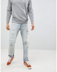 ASOS - Slim Jeans In Light Wash Blue With Heavy Rips - Lyst