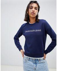 Calvin Klein - Felpa girocollo con logo istituzionale - Lyst
