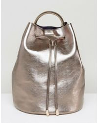 Pieces - Rose Gold Bucket Backpack - Lyst
