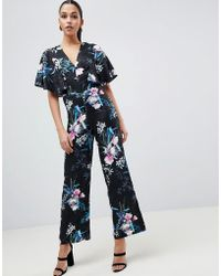 Lipsy - Cape Sleeve Floral Jumpsuit - Lyst