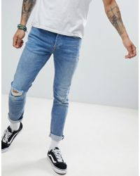 River Island - Slim Jeans With Rips In Mid Wash Blue - Lyst