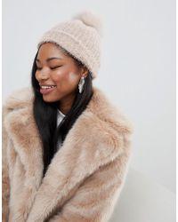 8c9b65c6c5c New Look Burgundy Double Faux Fur Pom Pom Hat in Brown - Lyst