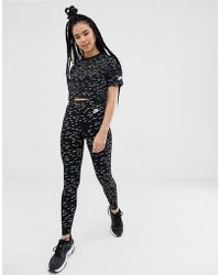 Nike - Black All Over Swoosh Print Leggings - Lyst