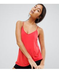 abab91957ece7 Lyst - Missguided Dafiya Satin Feel Crop Top with Curved Hem in Pink