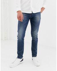 ASOS 12.5oz Skinny Jeans In Smokey Blue With Raw Hem