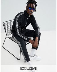 Pull&Bear - Exclusive Tracksuit Bottoms In Black With Logo Side Stripe - Lyst