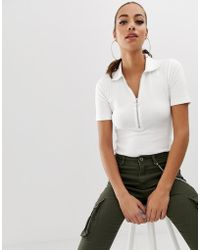 Missguided - Ribbed Zip Front Polo Neck Body In White - Lyst