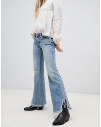 Free People - Vintage Raw Hem Flared Jeans - Lyst