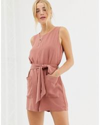 6ed0218c864 Glamorous Wrap Front Playsuit By in Pink - Lyst