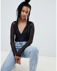 Ivy Park - Bodysuit mit Kapuze aus Netzmaterial - Lyst