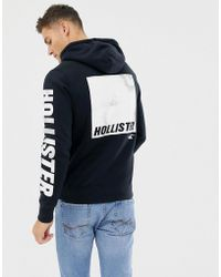 Hollister - Large Icon And Sleeve Logo Hoodie In Black - Lyst