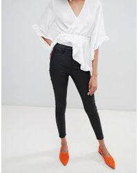 River Island - Harper Coated Skinny Jeans In Black - Lyst