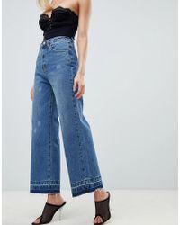 PrettyLittleThing - Wide Leg Raw Hem Jeans In Blue - Lyst