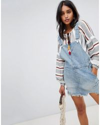 Free People - Torn Up Dungaree Dress - Lyst