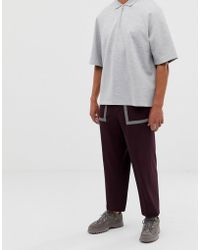 ASOS Wide Leg Smart Trouser In Techy Maroon With Reflective Tape Details