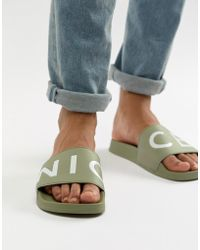 Nicce London Nicce Logo Sliders In Khaki - Green
