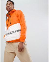 Calvin Klein - Logo Overhead Windbreaker Jacket - Lyst
