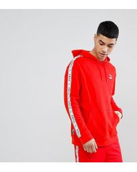 PUMA - Pullover Hoodie With Sleeve Taping In Red Exclusive To Asos - Lyst