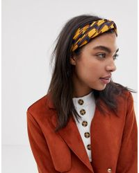 ASOS Headband With Oversized Twist Front In Geo Monogram Print