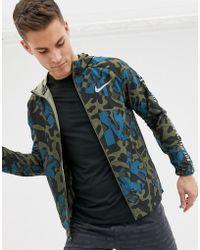 b16d5a783354 Nike Badlands Camo Windbreaker In Black 823369-010 in Black for Men ...