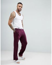 ASOS | Straight Leg Jersey Pajama Bottom With Branded Waistband In Burgundy | Lyst