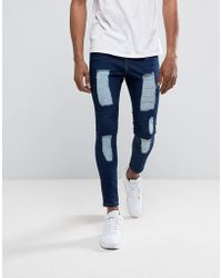 Illusive London - Super Skinny Jeans In Dark Wash Blue With Distressing - Lyst
