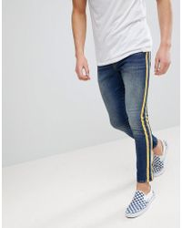ASOS - Super Skinny Jeans In Mid Wash With Yellow Side Stripes - Lyst