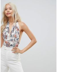 Love - Plunge Halter Neck Bodysuit In Floral Print - Lyst