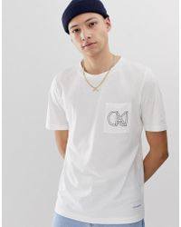 Calvin Klein - T-shirt con tasca stampata - Lyst