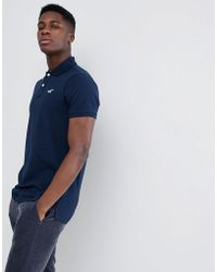 Hollister - Solid Core Seagull Logo Polo Contrast Placket In Navy - Lyst
