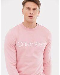 Calvin Klein Logo Front Crew Neck Sweatshirt In Pink