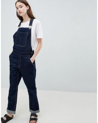 WÅVEN - Thea Rinse Indigo Denim Dungaree's With Wolf Embroidery - Lyst