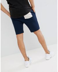ASOS - Design Jersey Skinny Shorts In Navy With Beige Fabric Interest Pocket - Lyst